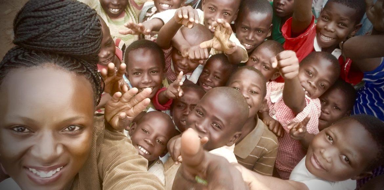 Director Bernadete Naganwaki with children supported by Future Upgrades Foundation